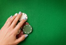 live dealer - image of hand and chips on a table