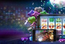 Online casino gambling concept image for celebrating 2020 New Year. Slot, poker, roulette games on mobile devices and mirror ball, balloons, confetti in the background. 3D illustration with copy space