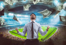 Man who rejoices at the stadium for winning a rich soccer bet