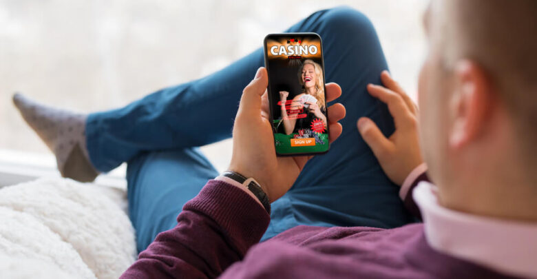Man using online casino app on his mobile phone