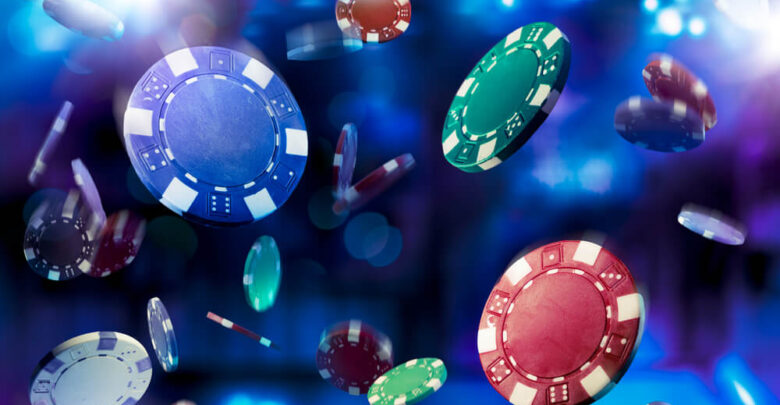Poker Chips falling with dramatic lighting