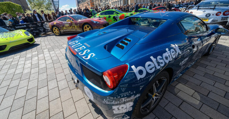 STOCKHOLM, SWEDEN - MAY 23: Gumball 3000 cars at display on the streets of Stockholm on May 23, 2015. People at the streets admiring the exotic cars at display before the start of the 2015 event.