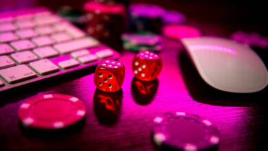 fast payout casino: Online casino. Online poker. On the table there are game pieces and dice next to the keyboard. Game chips for betting in gambling. Dice. Poker chips.